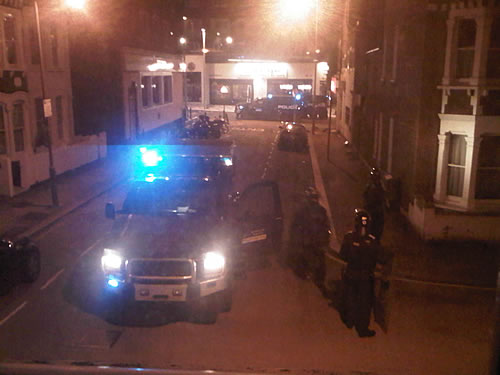 London Riots: Police cars and forces arriving at midnight.